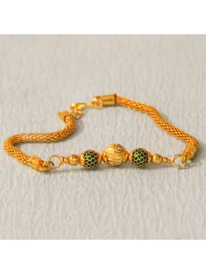 Gold Plated Net And Bead Rakhi.