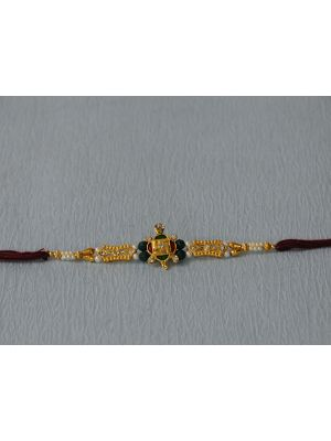 Gold Plated Rakhi With Swastik